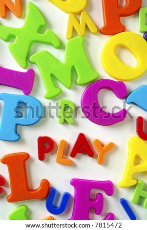 Macro composition of colorful plastic toy letters with the word PLAY - stock photo