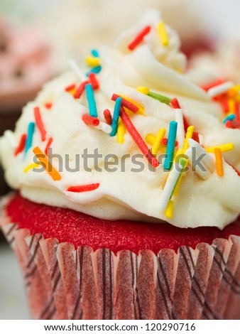 macro detail muffin with colorful sprinkles - stock photo