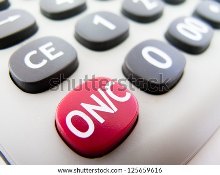 Macro detail of the ON button of a calculator - stock photo