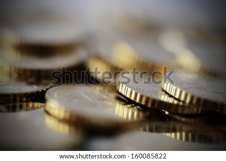 Macro euro coins piled isolated shallow depth of field