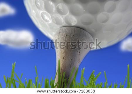 Macro Golf ball on the tee and blue sky - stock photo