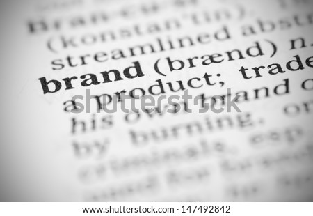 Macro image of dictionary definition of word brand