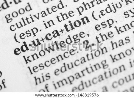 Macro image of dictionary definition of word education - stock photo