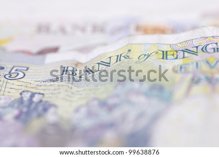 Macro image of English bank notes. Focus on ���£5 note. - stock photo