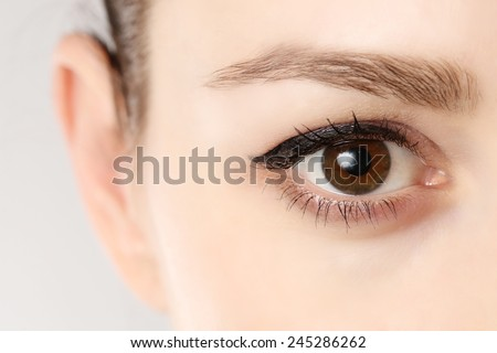 Macro image of human eye, Close up view of a brown woman eye  - stock photo