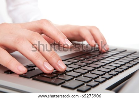 Macro image of human hands typing on keyboard - stock photo