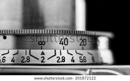 Macro image of the shutter speed adjustment on a vintage range-finder camera - stock photo