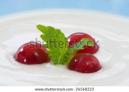 Macro image of yogurt and fruit. Blue background. Fresh and healthy food. - stock photo