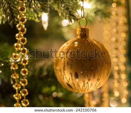 Macro images of xmas decoration on Christmas tree illuminated by lights - stock photo