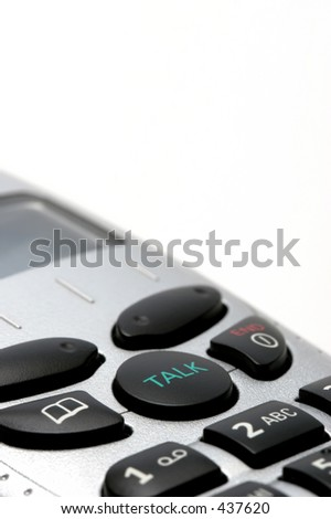 "macro of a cordless phone handset over white, with focus on the ""talk"" button"
