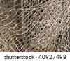Macro of a fishing net background texture - stock photo