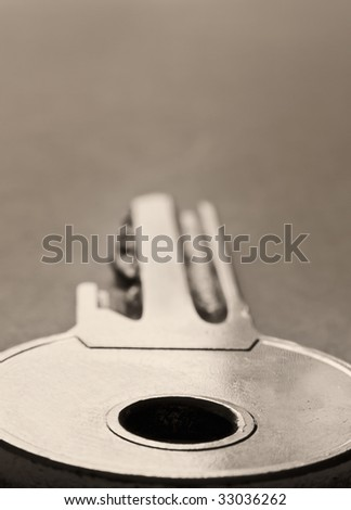 macro of a key,shallow DOF, sepia toned - stock photo