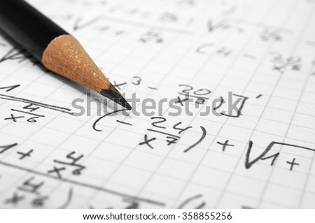 Macro of a paper with maths-formulas and a pencil - stock photo