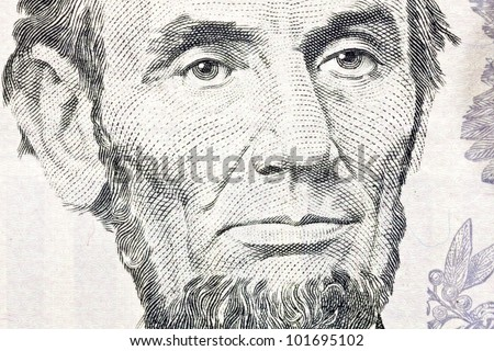Macro of Abe Lincoln on the US five dollar bill. - stock photo
