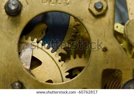 Macro of alarm-clock gearwheels - stock photo