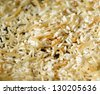 Macro of Browning Rice a close up of rice being browned before water is added in a pan. - stock photo