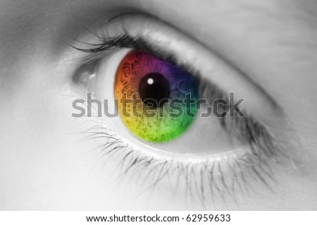 Macro of childs eye with rainbow colors - stock photo