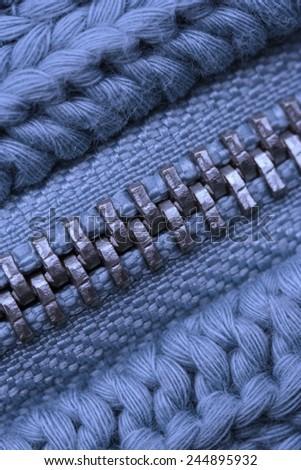 Macro of Closed Zipper on Sweater - Detail of Knitting Pattern - stock photo