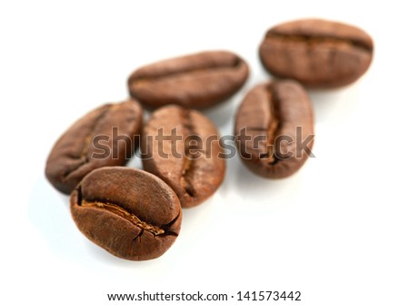 Macro of coffee beans isolated on white background - stock photo
