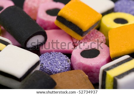 macro of colorful licorice allsorts sweets - stock photo