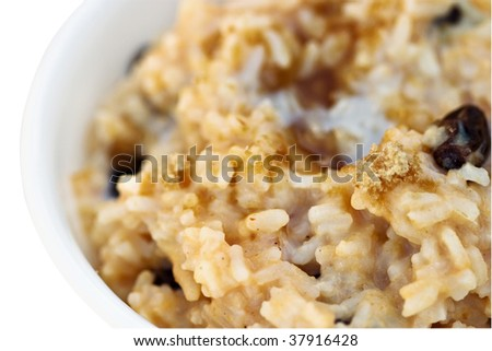 Macro of delicious sweet pumpkin custard rice with brown sugar sprinkled on top. Extreme shallow DOF with focus on front of rice. Clipping path included. - stock photo