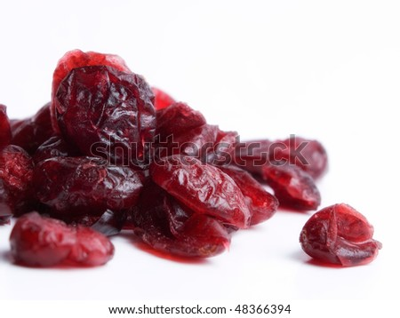 Macro of dried cranberries on a white background.