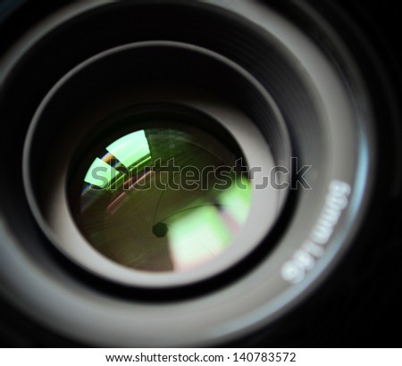 Macro of DSLR lens - stock photo