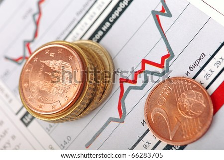 Macro of euro coins laying on financial graph. - stock photo