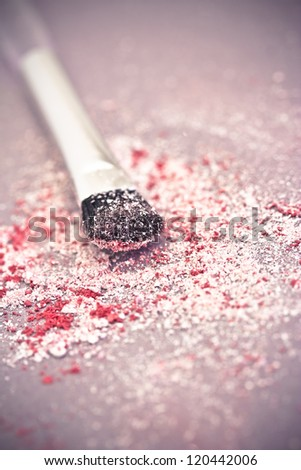 macro of eyeshadow powder and brush