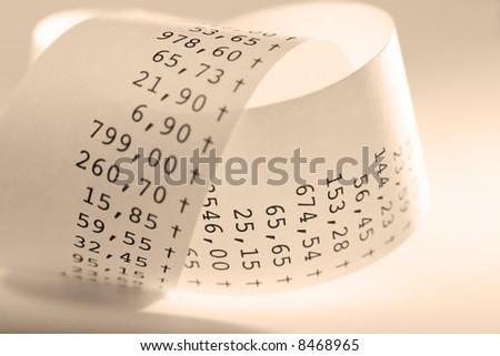 Macro of folded receit paper. Shallow DOF. Sepia tone. - stock photo