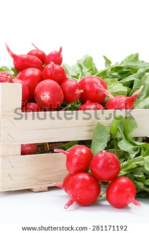 Macro of fresh red radish vegetable in wooden crate