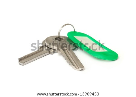 Macro of keys and green label isolated on white