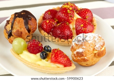 macro of miniature cakes on a white plate