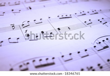 Macro of music with blue filter - stock photo