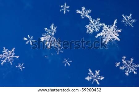 Macro of natural sparkle snow flakes - stock photo