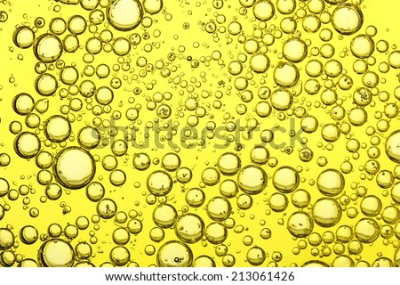 macro of olive oil for background use - stock photo