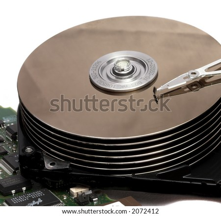 Macro of Opened Hard Disk Drive Isolated on White - stock photo