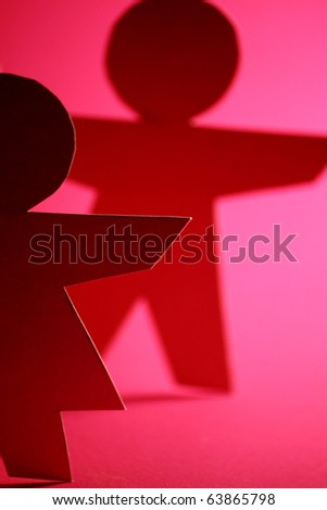 macro of paper man and woman - stock photo