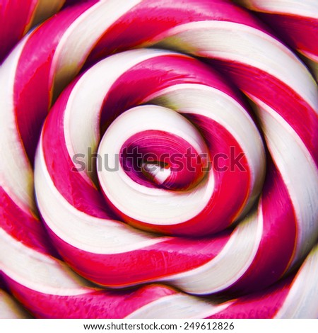 Macro of pink lollipop candy backdrop - stock photo