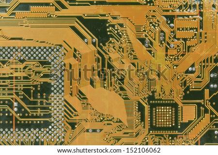Macro of printed circuit board - computer motherboard - stock photo