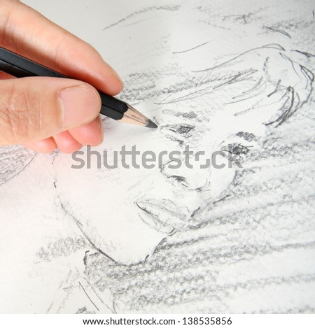 Macro of Sketching a Woman's Face with a Pencil - stock photo