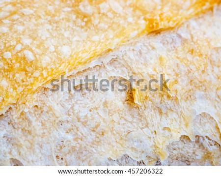 Macro of sourdough bread crust texture. Tasty fresh sourdough bread, close up for background - stock photo
