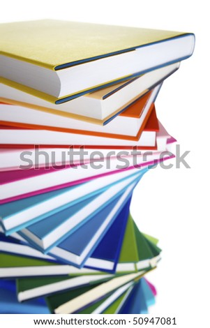 Macro of spiral stack of colorful real books on white background, top view. - stock photo