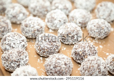 macro of sweet Indian coconut burfi treats with selective focus - stock photo
