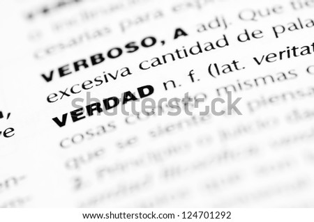 """macro of the word """"verdad"""" written in a Spanish dictionary - stock photo"""