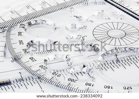 macro of transparent rulers on paper - stock photo