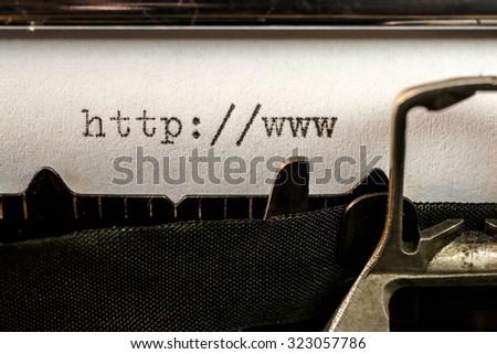 Macro of url text beginning written by old typewriter machine - stock photo