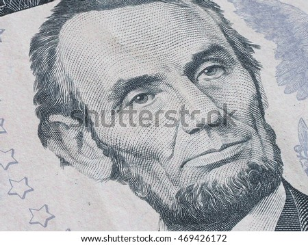 Macro of US dollar series, Abraham Lincoln, a close-up portrait on US five dollars