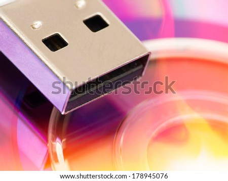 Macro of USB plug on dvd with flames, selective focus - stock photo