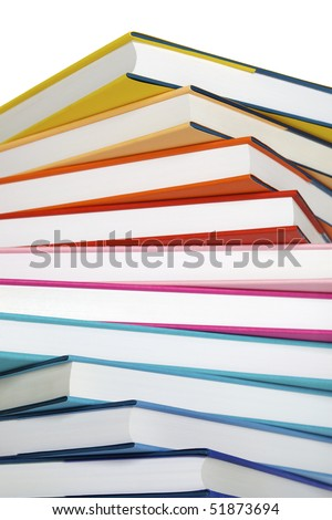 Macro of winding stack of colorful real books on white background. - stock photo